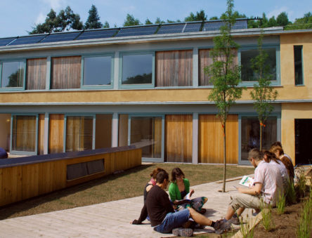 Students sitting outside the Wales Institute of Sustainable Education